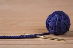 Ball of blue yarn with crochet needle Stock Photography