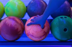 Ball bowling green pink in infrared light, hand selection Stock Photos