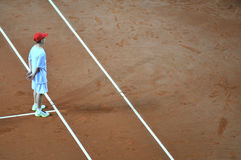 Ball boy in action during a tennis match Royalty Free Stock Images