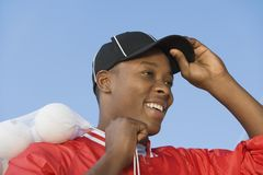 Ball boy ajusting hat Royalty Free Stock Photography