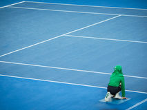 Ball Boy at Australian Open Tennis. A ball boy waits at the ready during a tennis match at the 2017 Australian Open Royalty Free Stock Photography