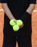 Ball boy holding Babolat tennis balls at Roland Garros 2015 Stock Image