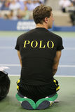 Ball boy on tennis court at the Billie Jean King National Tennis Center during US Open 2014 Royalty Free Stock Images