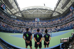 Ball boys on Arthur Ashe Stadium during US Open 2016 at the Billie Jean King National Tennis Center. NEW YORK - SEPTEMBER 6, 2016: Ball boys on Arthur Ashe Stock Images