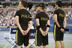 Ball boys on tennis court at the Billie Jean King National Tennis Center during US Open 2014 Royalty Free Stock Photos