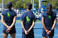 Ball boys on tennis court during US Open 2016 at the Billie Jean King National Tennis Center Stock Image