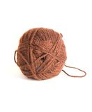 Ball of brown wool thread for knitting isolated. On white background royalty free stock images