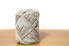 Ball of brown yarn on white background. Ball of brown yarn Stock Photo