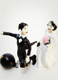Ball and chain. Funny wedding cake figurines on white background Stock Photography