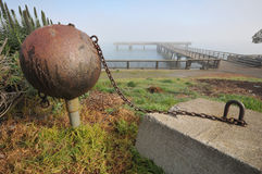Ball and chain attached to concrete block Royalty Free Stock Images