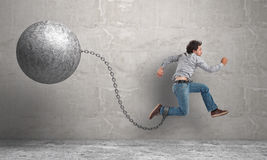 Ball and chain. Running man with ball and chain Stock Photo