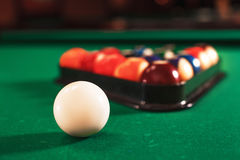 Ball and chalk on the billiard table. Stock Image
