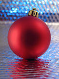 Ball for Christmas-tree on brilliant background Stock Photos