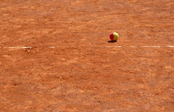 Ball on clay tennis court Royalty Free Stock Photos