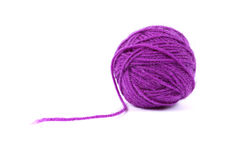 Ball clew of mauve wool. Ball of mauve wool isolated on white Stock Image
