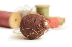 Ball and coils of thread Stock Image