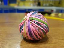 Ball of colored rubber bands royalty free stock image