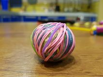 Ball of colored rubber bands stock photos