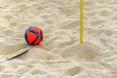 The ball is in the corner waiting to be kicked on a beach soccer. Field Royalty Free Stock Images