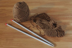 Ball of cotton & needle work. On wooden table Royalty Free Stock Photos