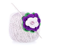 Ball of cotton yarn with knitted flower Royalty Free Stock Photo