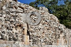 Ball Court Goal Yoke. This is a picture of a goal yoke on the ancient Mayan Ball Court located in the Uxmal Archeological Zone located in Uxmal, Mexico. The goal stock image