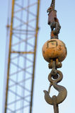 Ball and Crane. A rusty ball and crane hook Stock Photo