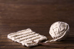 Ball of cream yarn with crochet hook Stock Photo