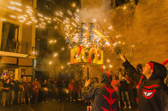 Ball de Diables on Correfoc in El Vendrell. EL VENDRELL, SPAIN - JUL 26: Ball de Diables (Devils dance) Group on Correfoc (Firerun) performance within the Festa Stock Photo
