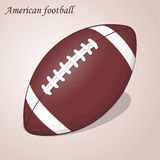 Ball des amerikanischen Fußballs auf einem rosa Hintergrund Auch im corel abgehobenen Betrag Rugbysport Stockbild