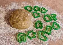 Ball of dough  with dusting of flour and cookie cutter forms Royalty Free Stock Photography