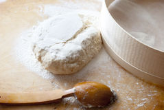 Ball of dough and spoon Royalty Free Stock Photos