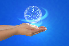 Ball of energy floating on palm. Concept of power and energy control royalty free stock photo