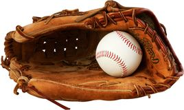 Baseball glove with a ball in it - isolated image stock photography