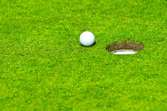 Ball falls in hole royalty free stock images