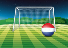 A ball at the field with the flag of Netherlands Royalty Free Stock Photography