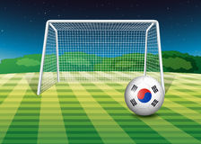 A ball at the field with the flag of South Korea Royalty Free Stock Photo
