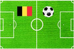 Ball and flag of Belgium on the background of a football field Stock Photos