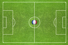 Ball with flag of France on the field Royalty Free Stock Image