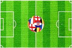 The ball from the flags of England, Belgium, France and Croatia on the background of a football field stock images