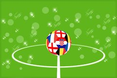 The ball from the flags of England, Belgium, France and Croatia on the background of a football field royalty free stock photography
