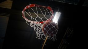 The ball flies into the basket, basketball. Slow motion stock video footage