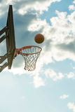 The ball flies into the basketball Stock Image
