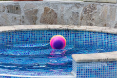 The ball floating in a pool Royalty Free Stock Image