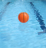 Ball floating on the swimming pool Stock Photos
