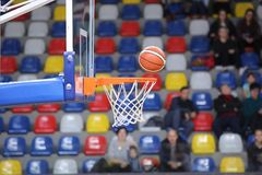 The ball is flying in the basket. Basketball royalty free stock photo