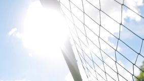 Ball flying into football goal net. Sport, soccer and game - ball flying into football goal net stock footage