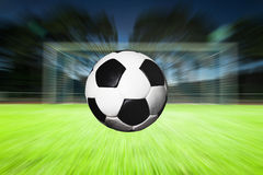 Ball flying into goal. With speed royalty free stock images