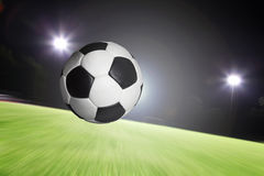 Ball flying into goal. With speed stock photography