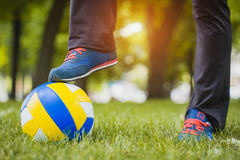 Ball with foot of player touching it Royalty Free Stock Photos